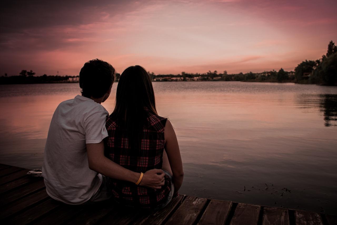 couple looking across the lake