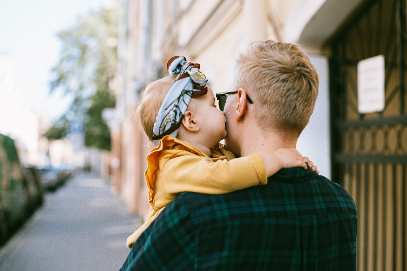 child kissing father's cheek