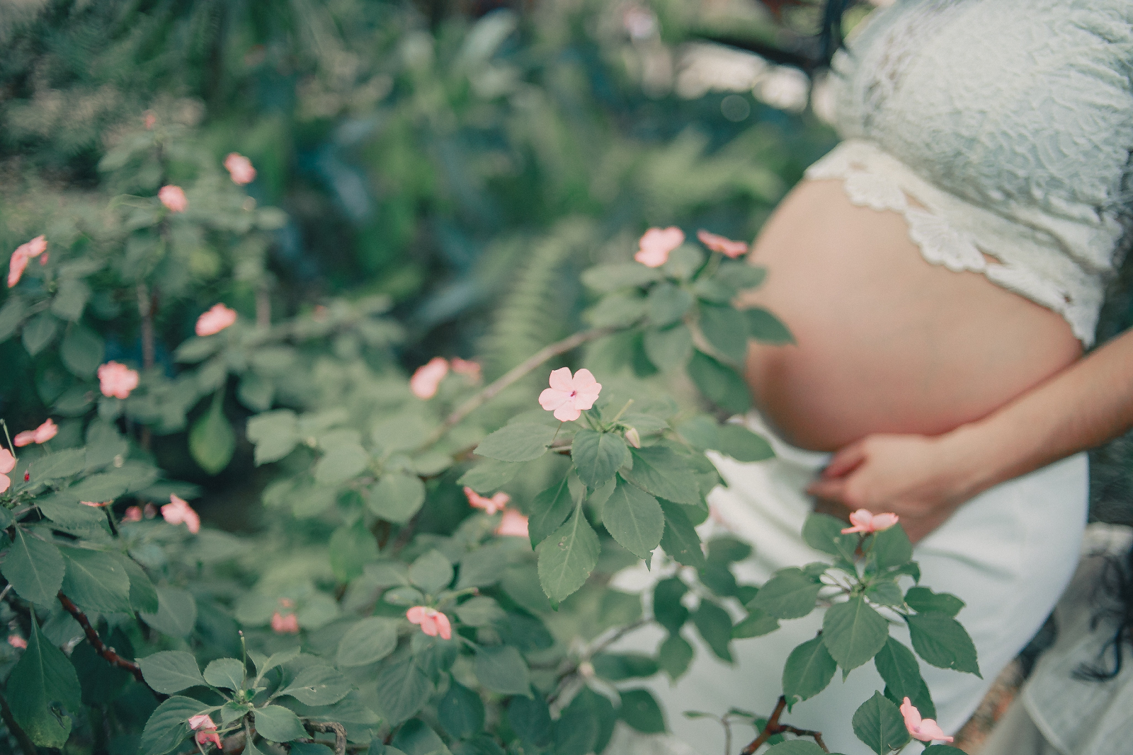 pregnant woman by flowers