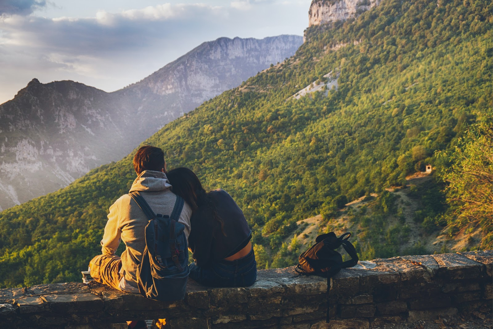 A couple looks out over a scenic view of the mountains, while contemplating their fertility journey.