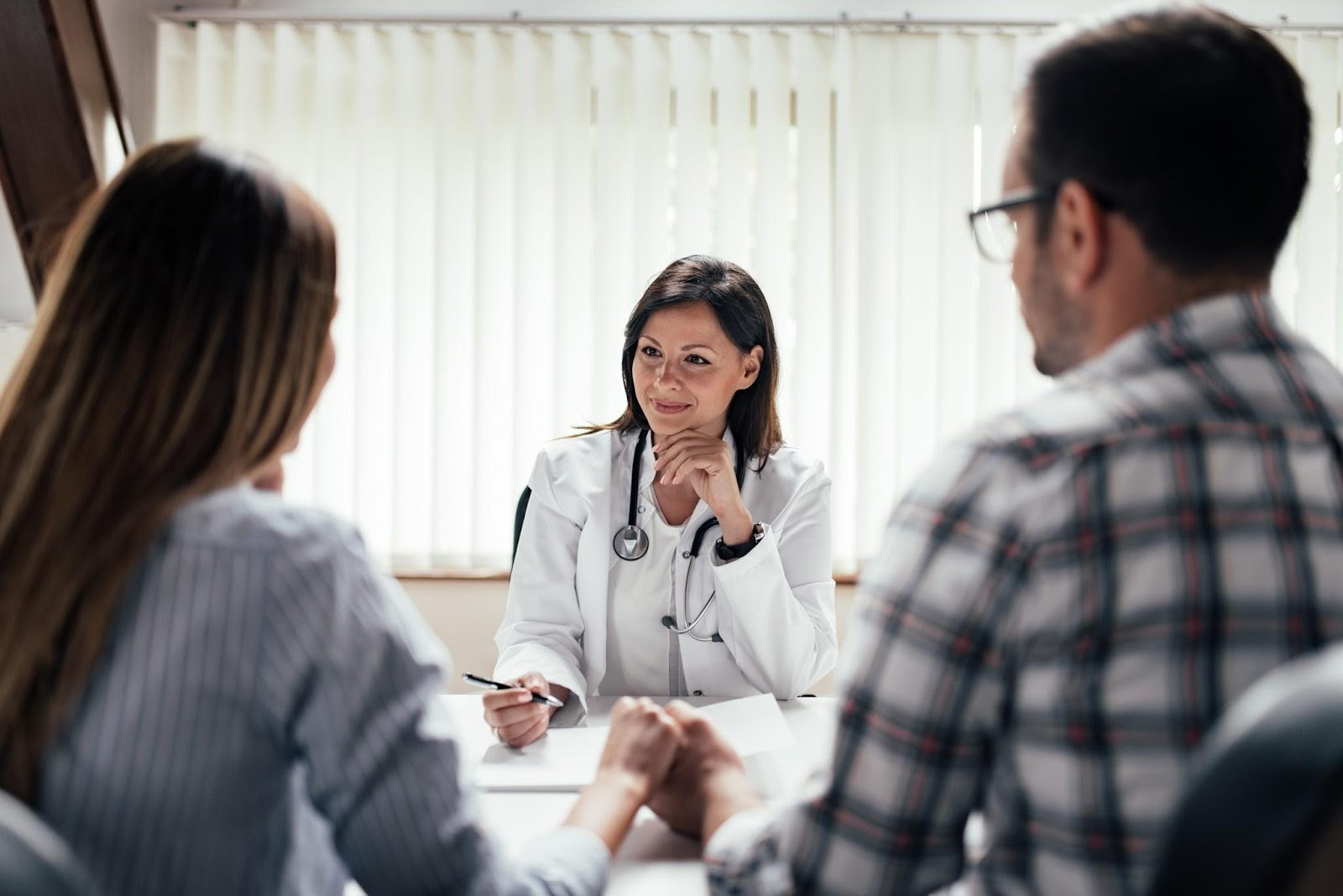 Couple visits a doctor for fertility consultation