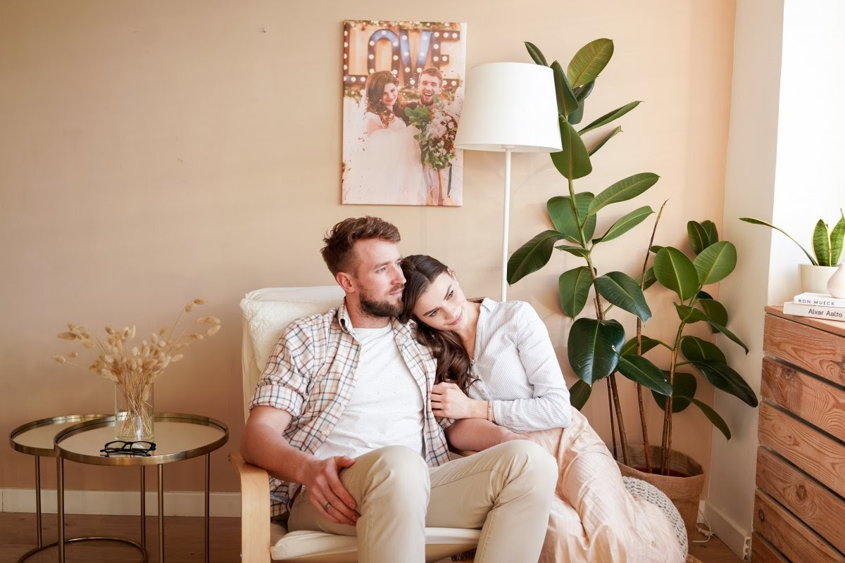 A couple relaxes in their living room after having a meaningful conversation about their pregnancy.