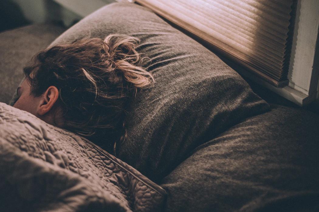 Woman in grey bed sleeping