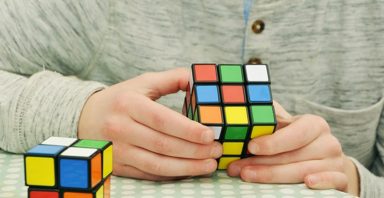 Man solves a Rubik's cube and avoids blue light before bed.
