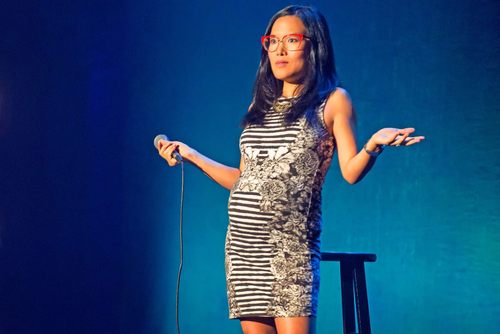 Comedian Ali Wong stands on stage and jokes about her miscarriage in the Netflix special Baby Cobra.