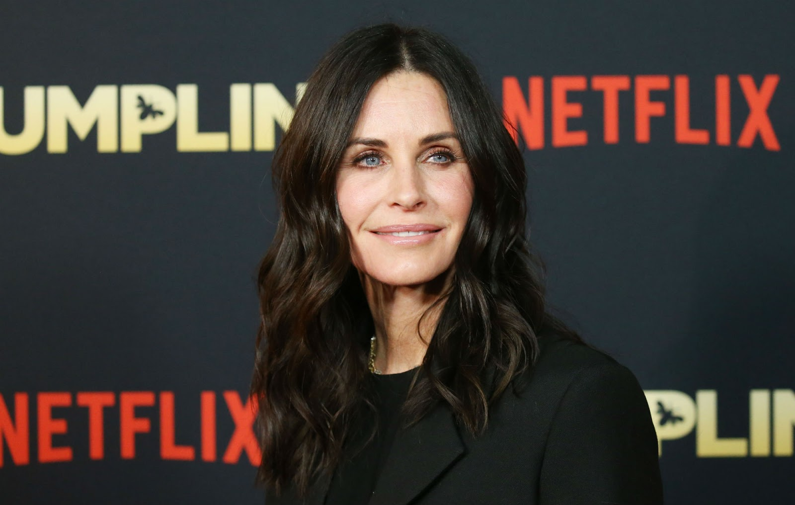 Courteney Cox poses at the red carpet event for Dumplin.