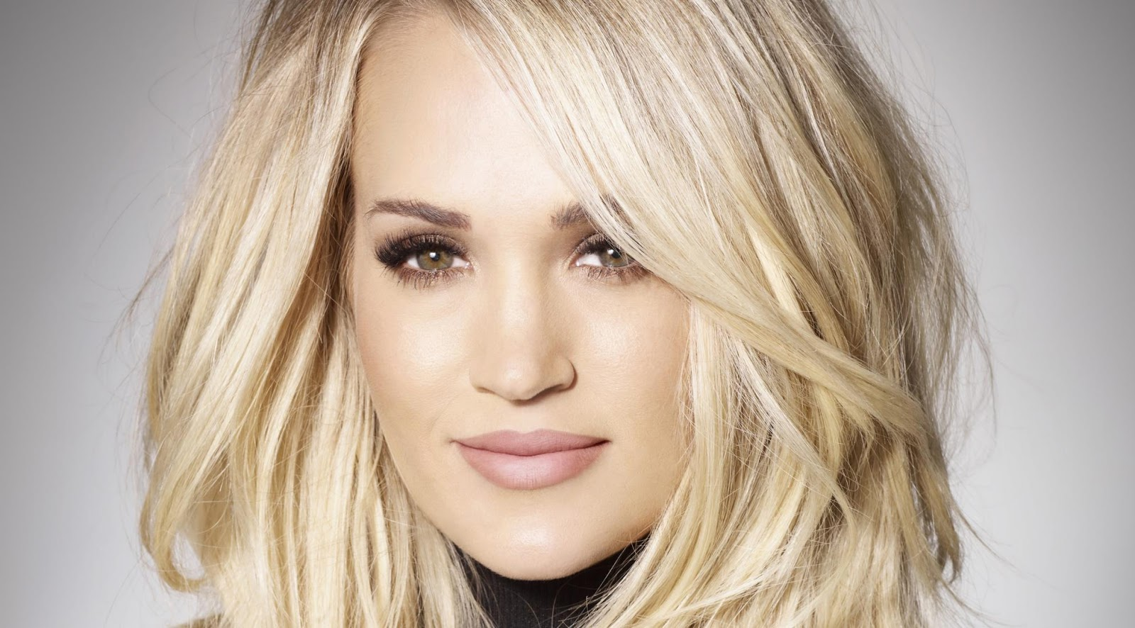Carrie Underwood smiles for the camera in this Grammy close-up shot.