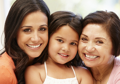 Photo of a mother, a daughter, and a grandmother smiling