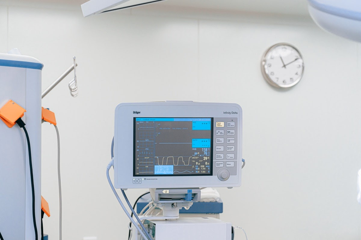 Image of a monitor in a doctor's office displaying a patient's vitals and data