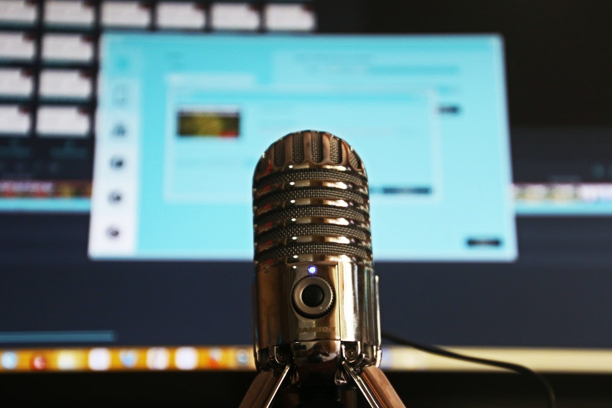 a microphone in front of a computer screen