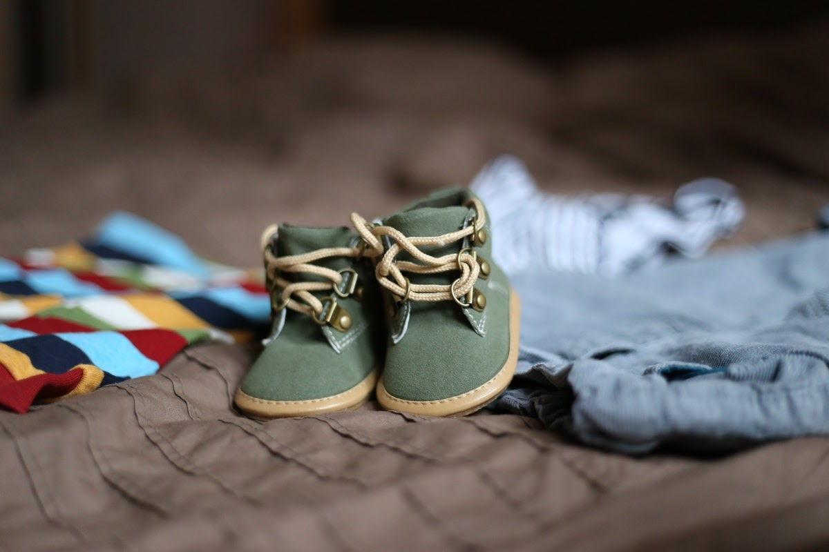 a pair of green baby shoes