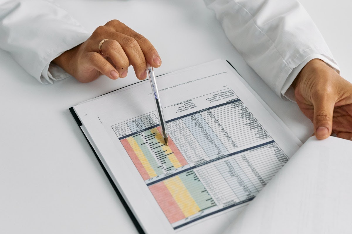 a doctor looking at data tables