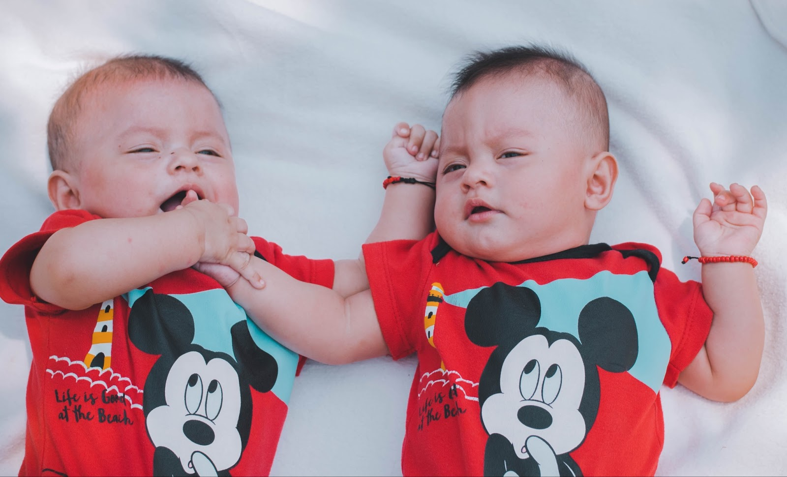 Twin babies lying next together