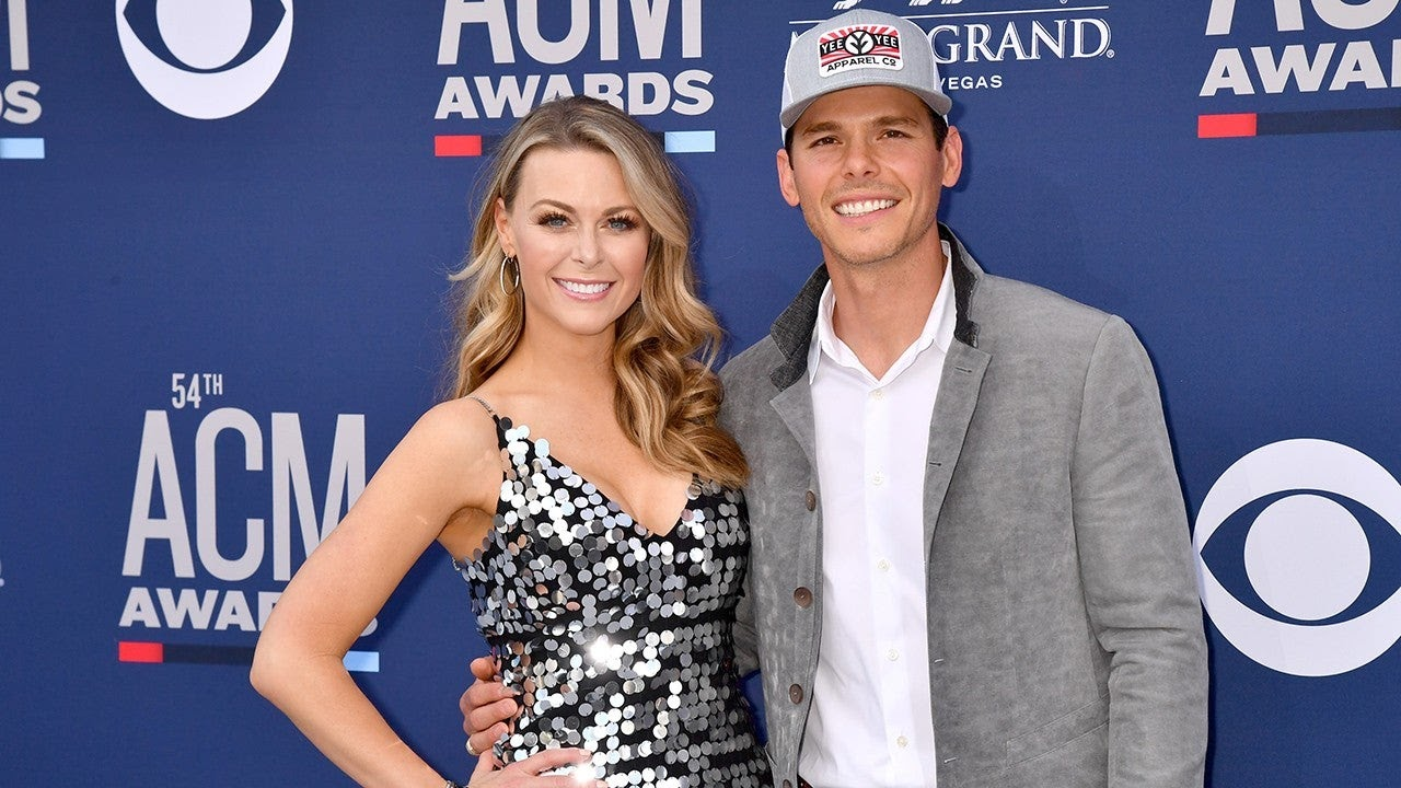 Amber Smith, left, and Granger Smith, right, at the American Country Music Award red carpet