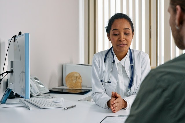 Doctor sitting across from patient at desk
