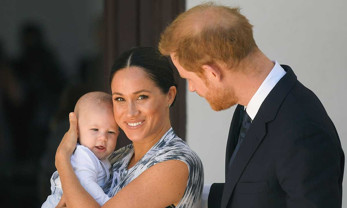 Meghan and Harry holding Archie