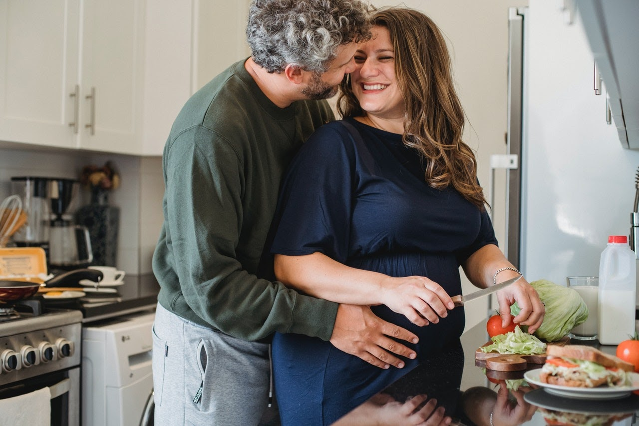Couple embracing while cooking