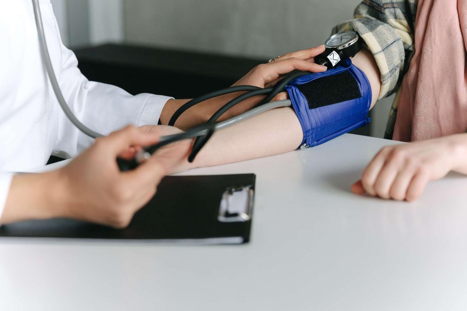 Doctor dating blood pressure