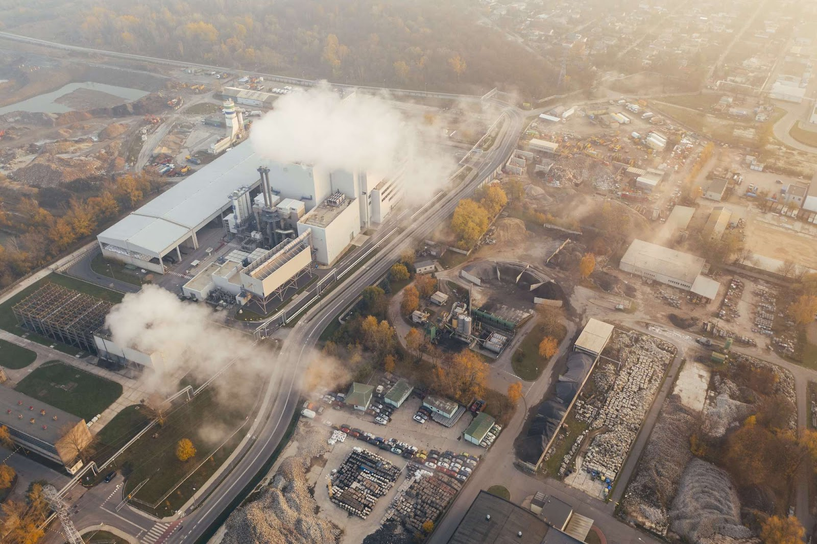 Overhead view of factory spewing emissions