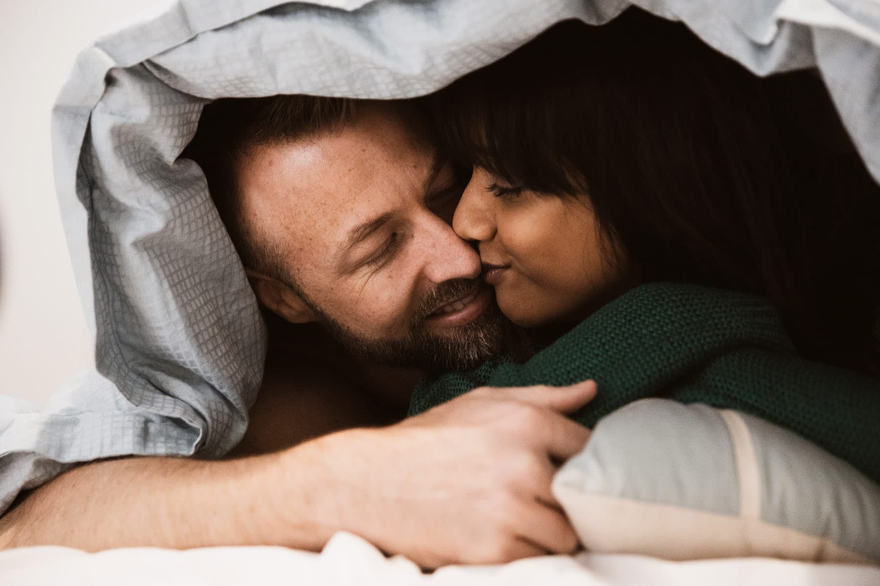 Re-explore your relationship and get to know each other better. Cuddle in bed under the sheets together, it will make you and your partner feel closer to one another. Cuddling also heightens the sense of intimacy. Image courtesy of webmd.com.
