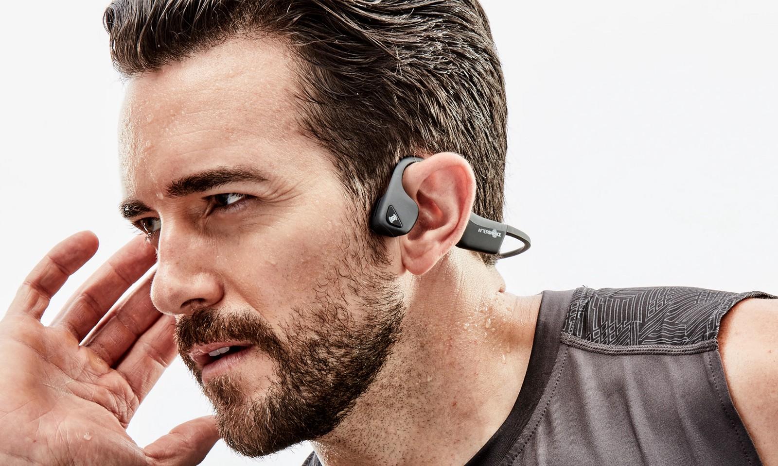 man wearing bluetooth headphones