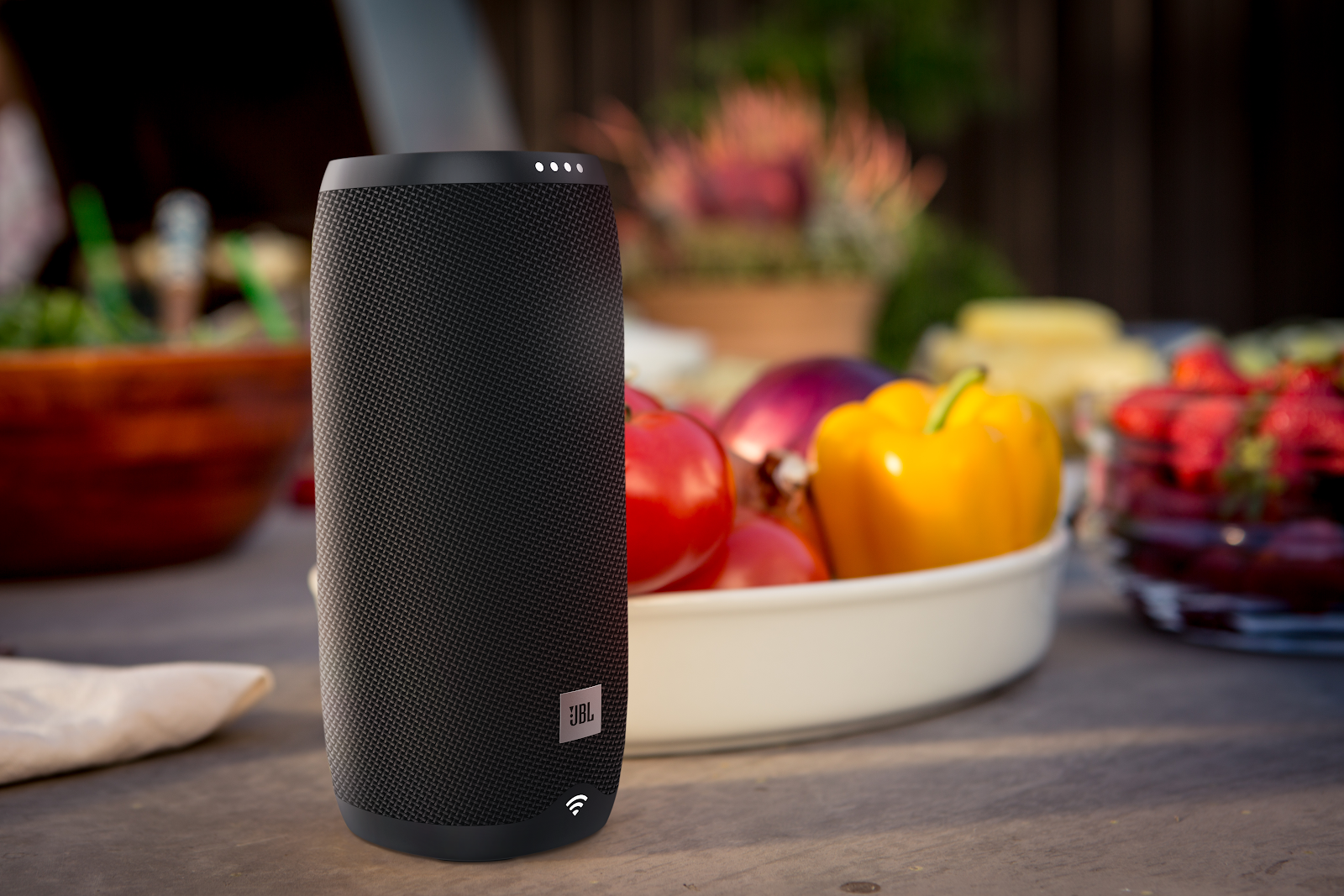 JBL wireless speaker on table with food