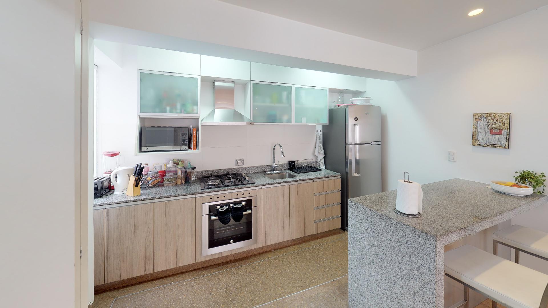 Cocina del recorrido virtual de un hermoso departamento en Sáenz Peña, Barranco, Lima, Perú