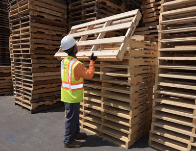 worker getting custom wooden pallets