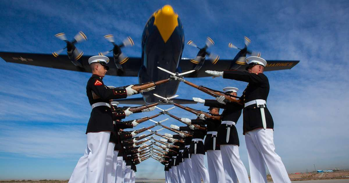military honor guard with low flying aircraft