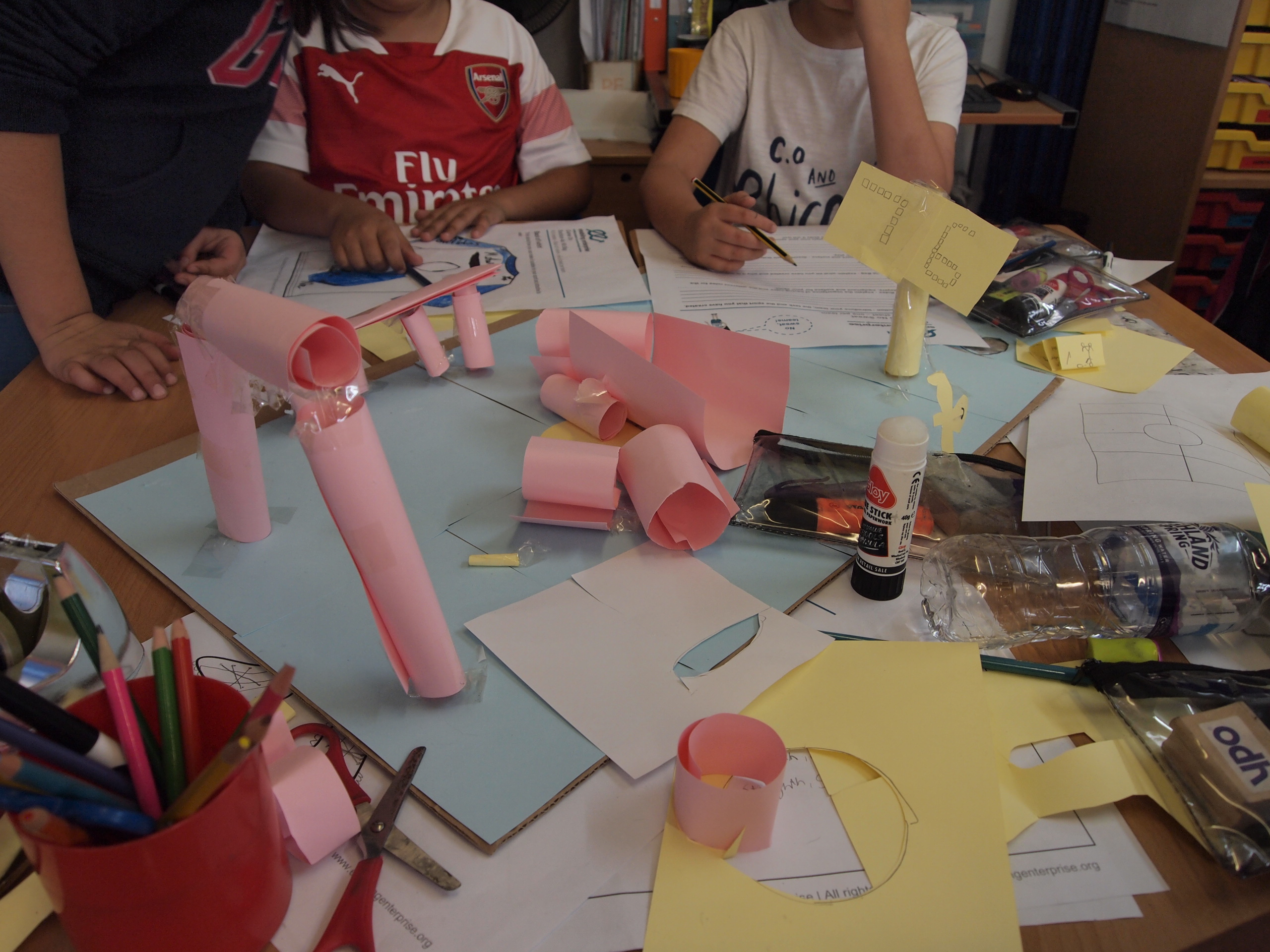 Year 5 teams putting their finishing touches on a 3D model of a brand new type of pitch before Presenting to the class
