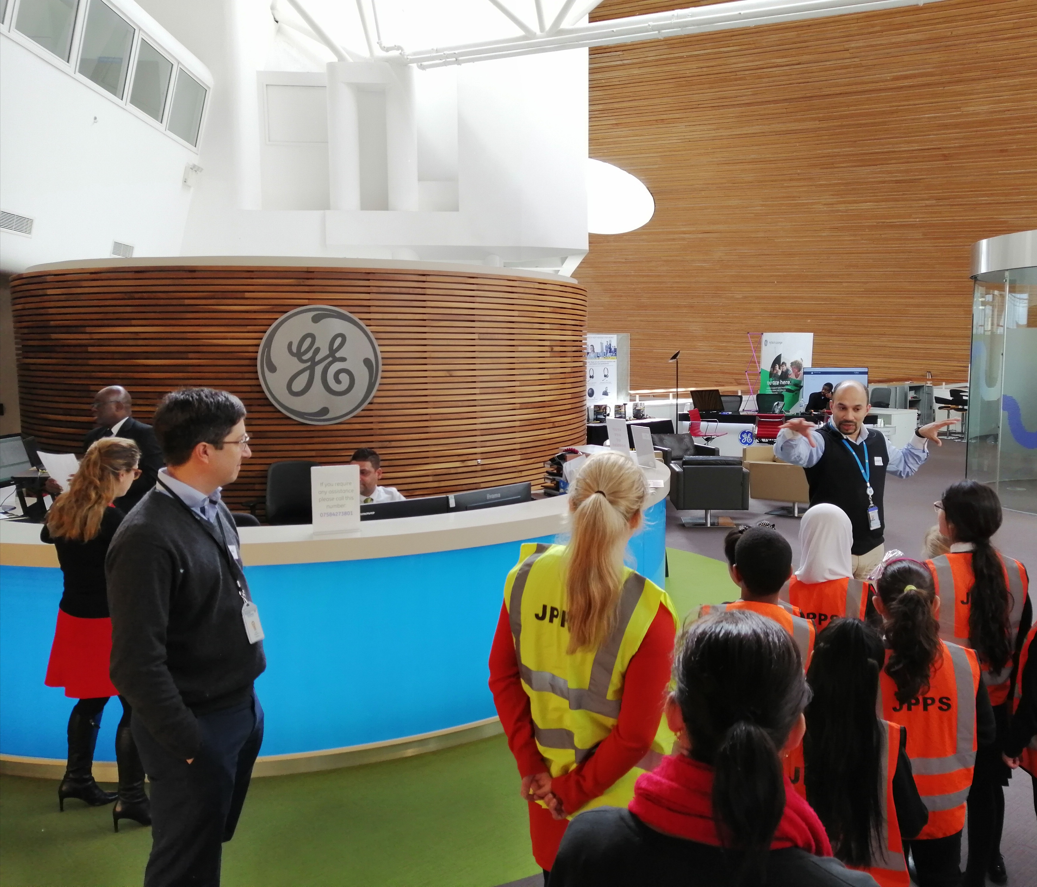 Listening skills in action as learners are given a tour of the GE offices.