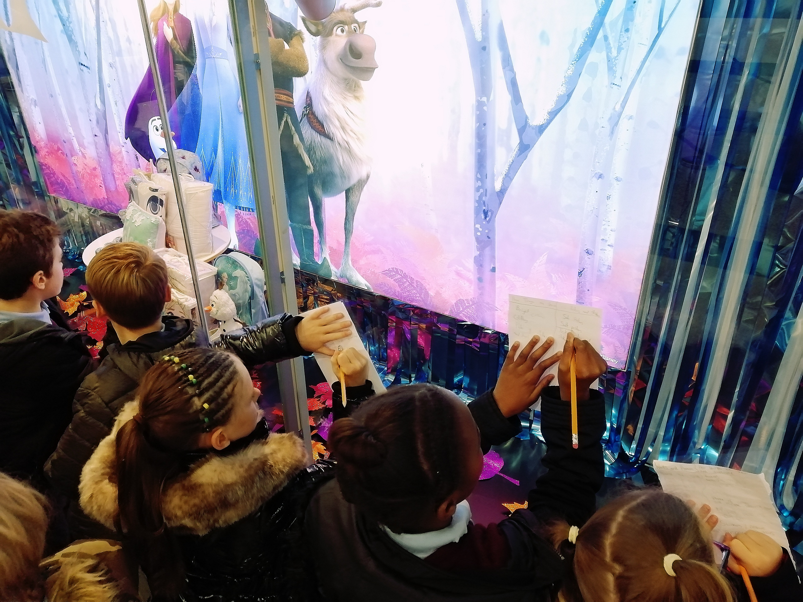 Learners use their Teamwork skills to research existing shop window displays.