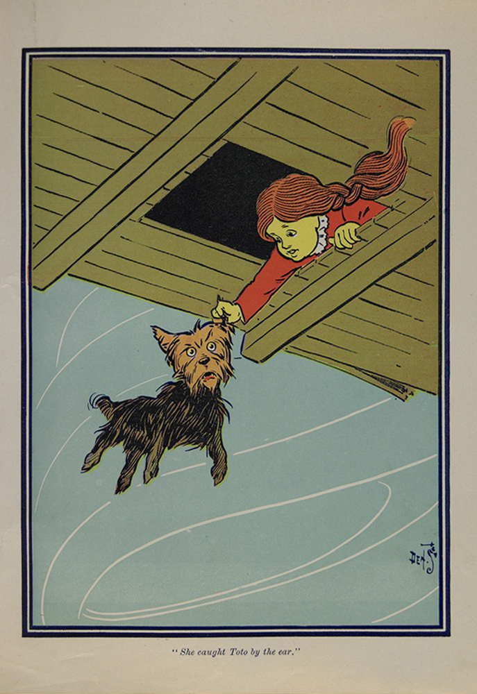 Dorothy catches Toto by the ear as they are swept away by the tornado.