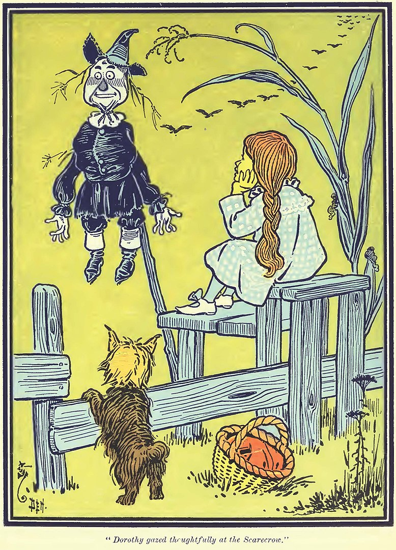 Dorothy gazes thoughtfully at the Scarecrow.