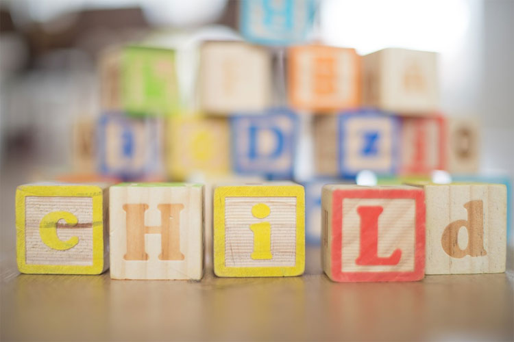 Chemical use is a major concern in a safe and healthy child care setting where blocks lie on the floor spelling child.