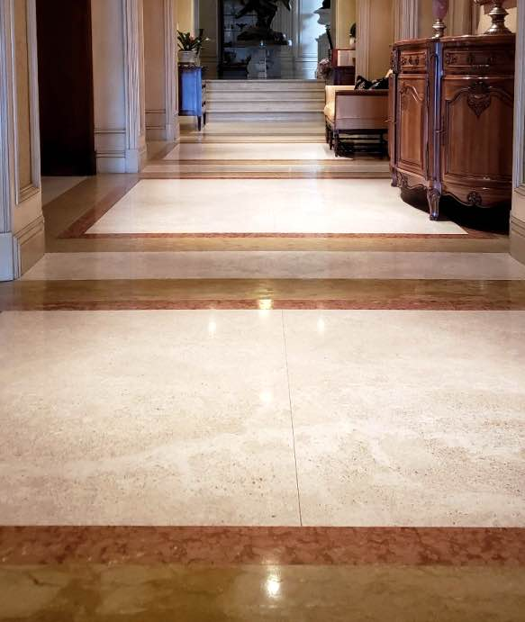 Travertine stone tile floor cleaned and polished
