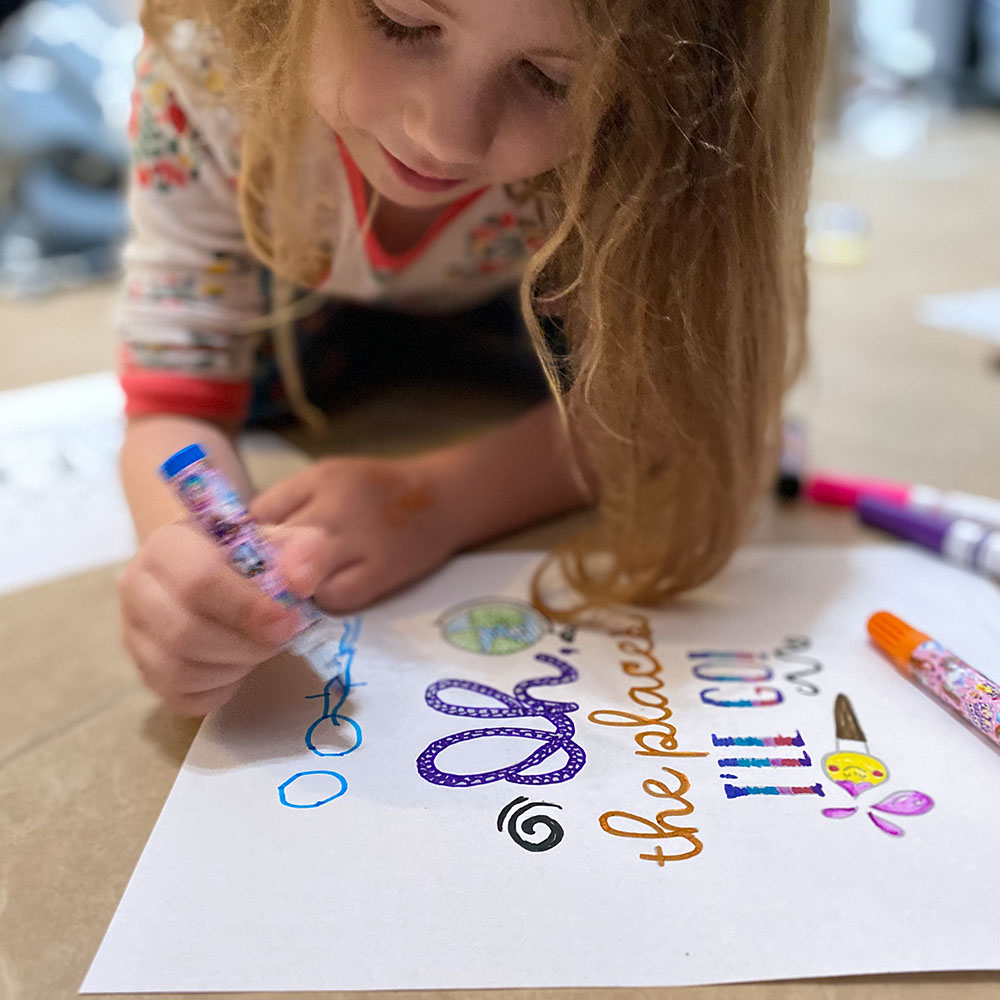 A young girl doing home school artwork