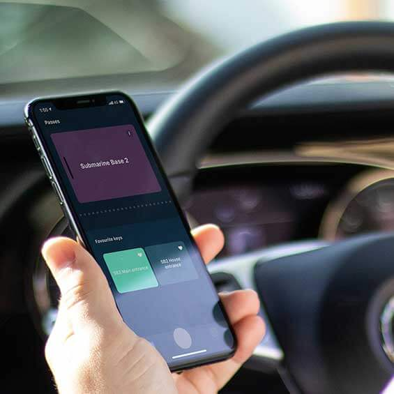 Image of Doordeck on a phone  being used in a car