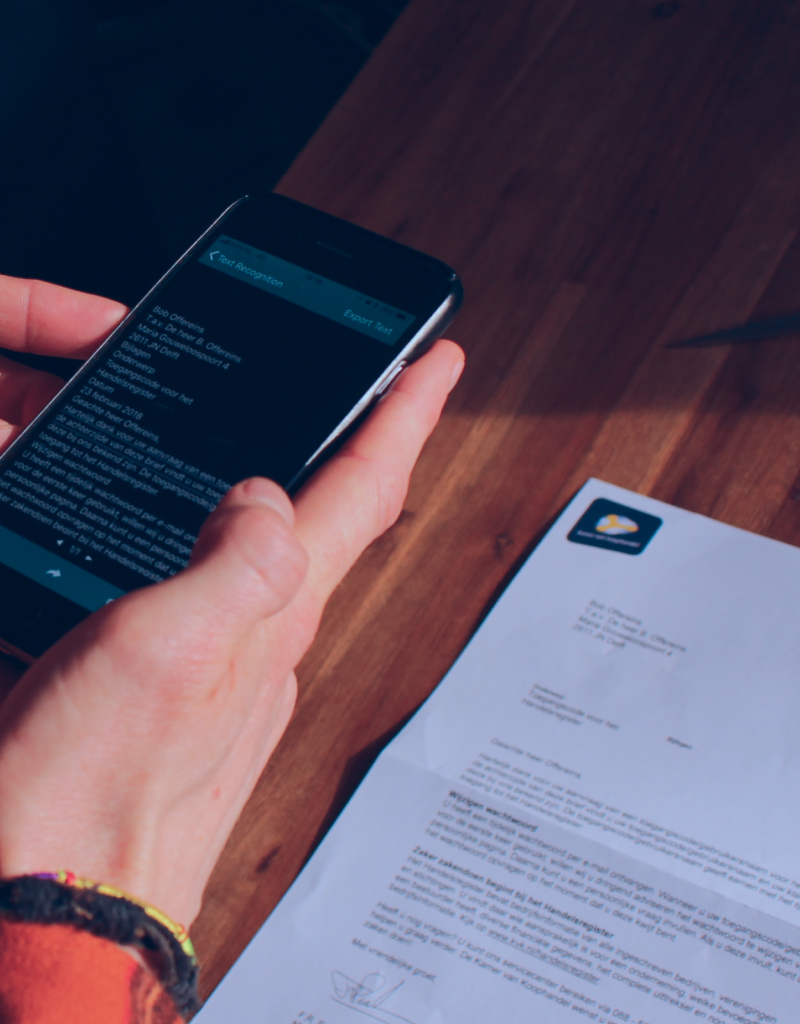 Photo of a person using Envision app to read a letter
