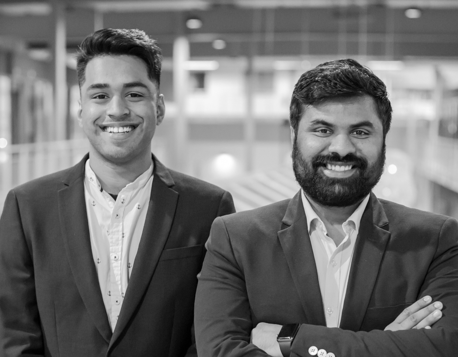 Picture of Karthik and Karthik wearing suits and smiling for the camera