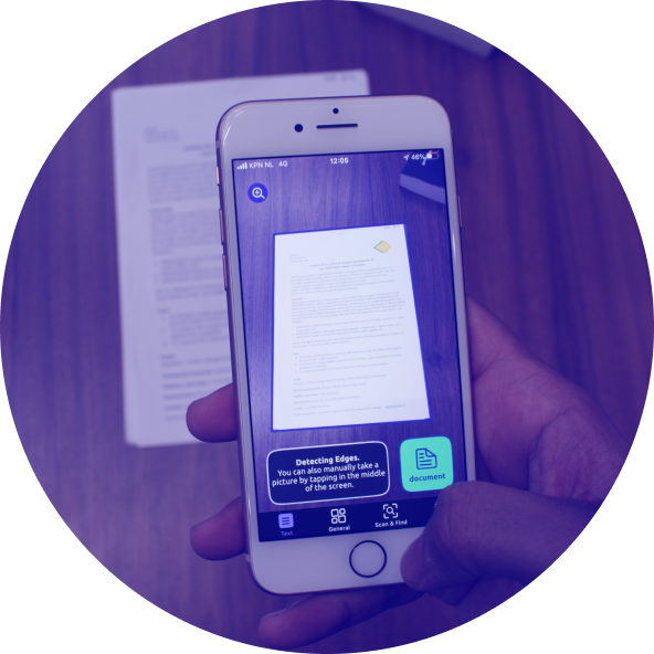 A hand holding a smartphone and scanning a document with the Envision app