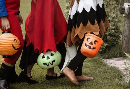 Trick-or-treaters walking on Halloween