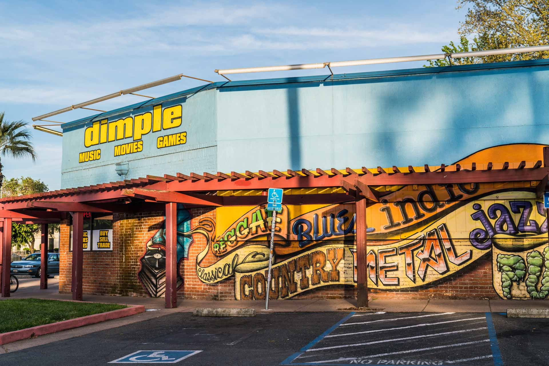 A mural outside of Dimple Records on Broadway in Curtis Park for Visit Sacramento.