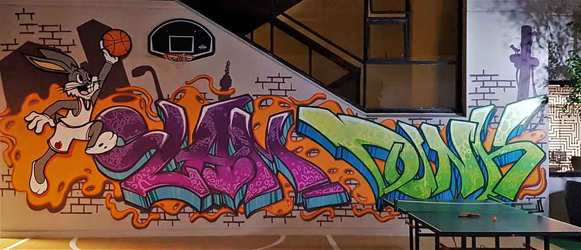 basketball court graffiti mural with a table tennis ping pong table on the side recreation areas