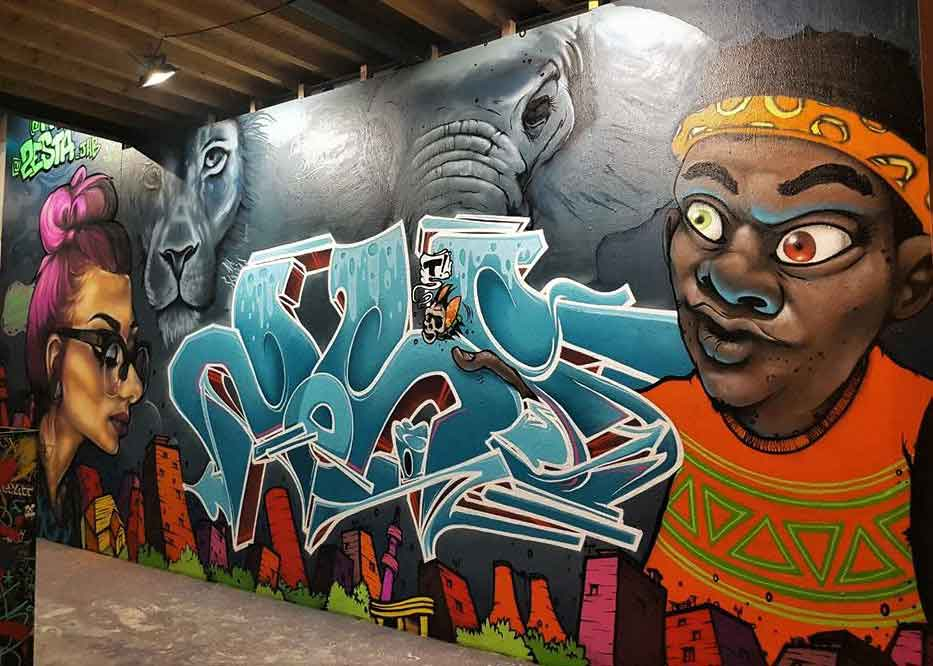 graffiti street art mural of lion, elephant skyline and african characters