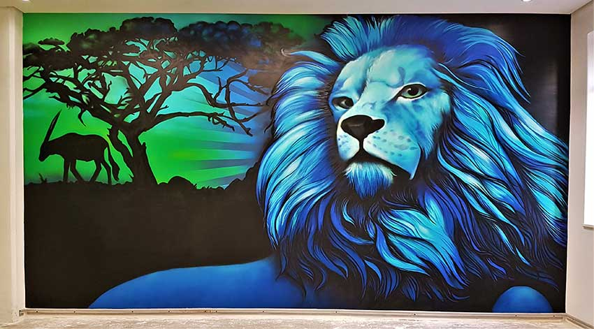 Wall mural painting blue lion and silhouette landscape background