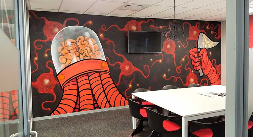 office graffiti wall art mural brain bot robot and neurons in think tank room