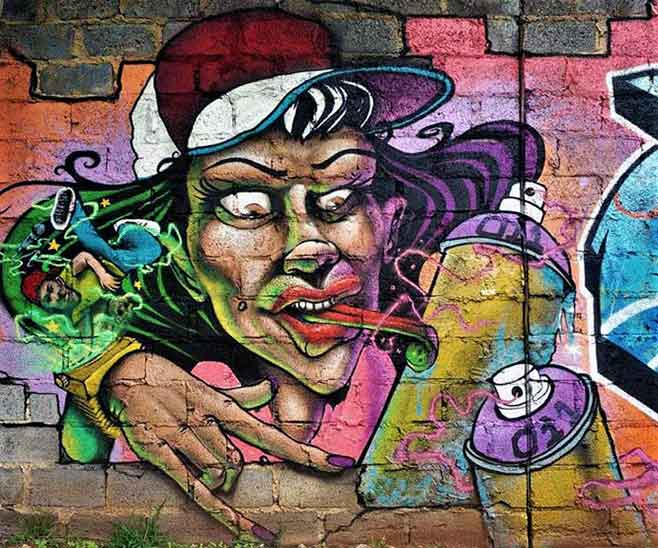 graffiti wall art mural, girl with tongue stuck to spraypaint can, breakdancer on her watch