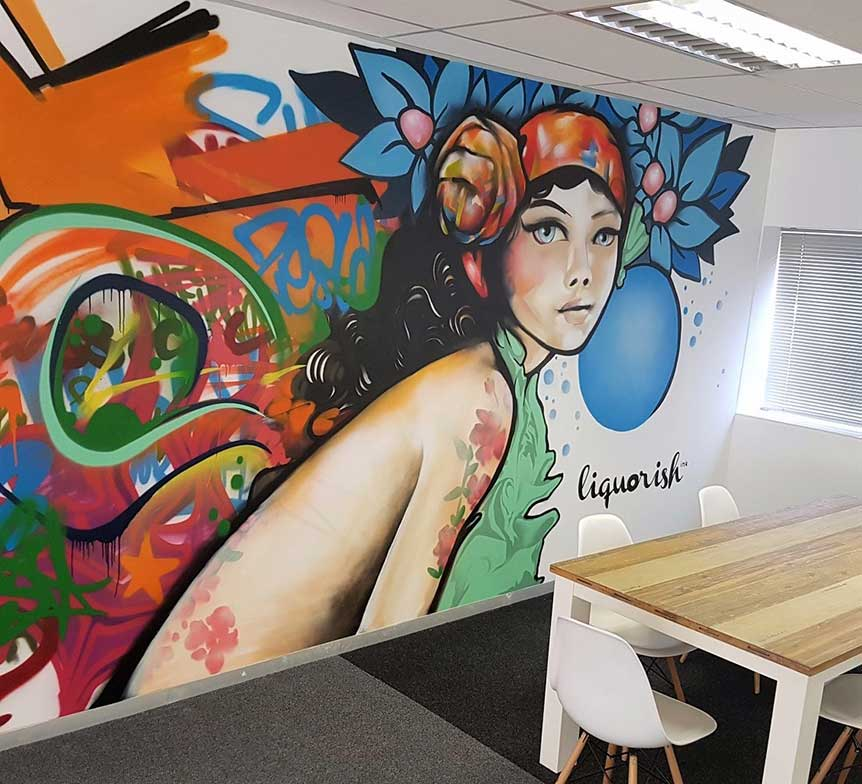 office mural portrait of lady with blue flowers and graffiti background