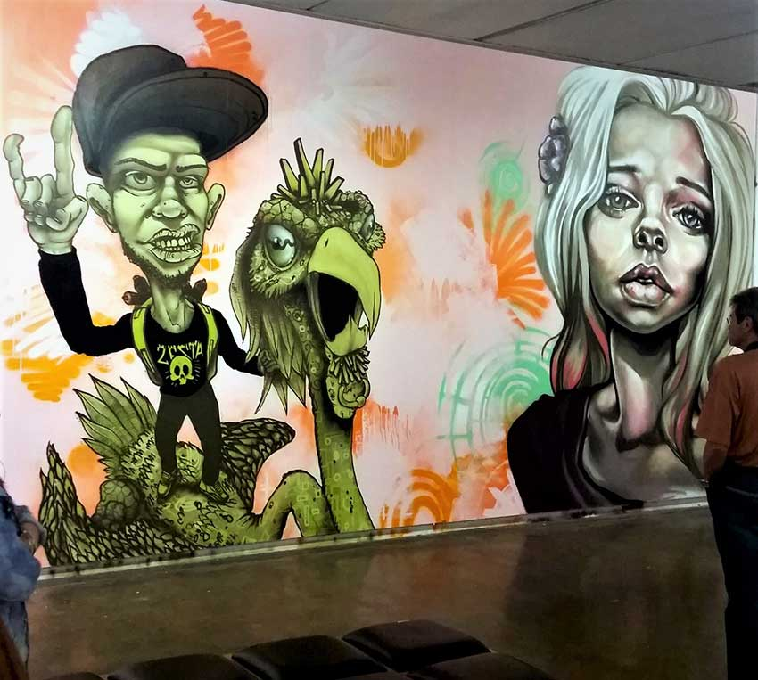 mural in joburg art gallery, female portrait and man riding fictional bird character
